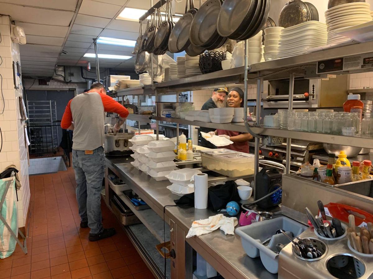 Three Monkeys staff prepare meals out of donated food coronavirus-19