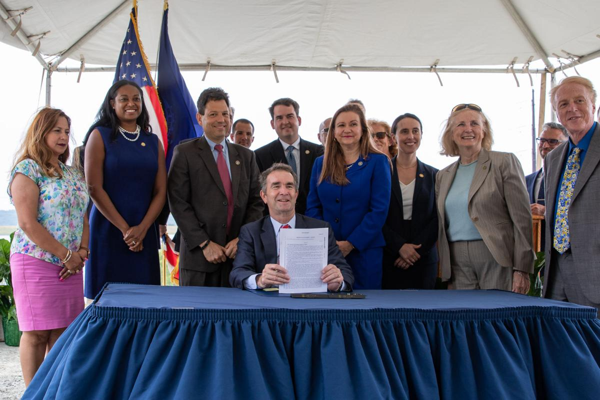 Gov. Ralph Northam, legislators, sign coal ash bill