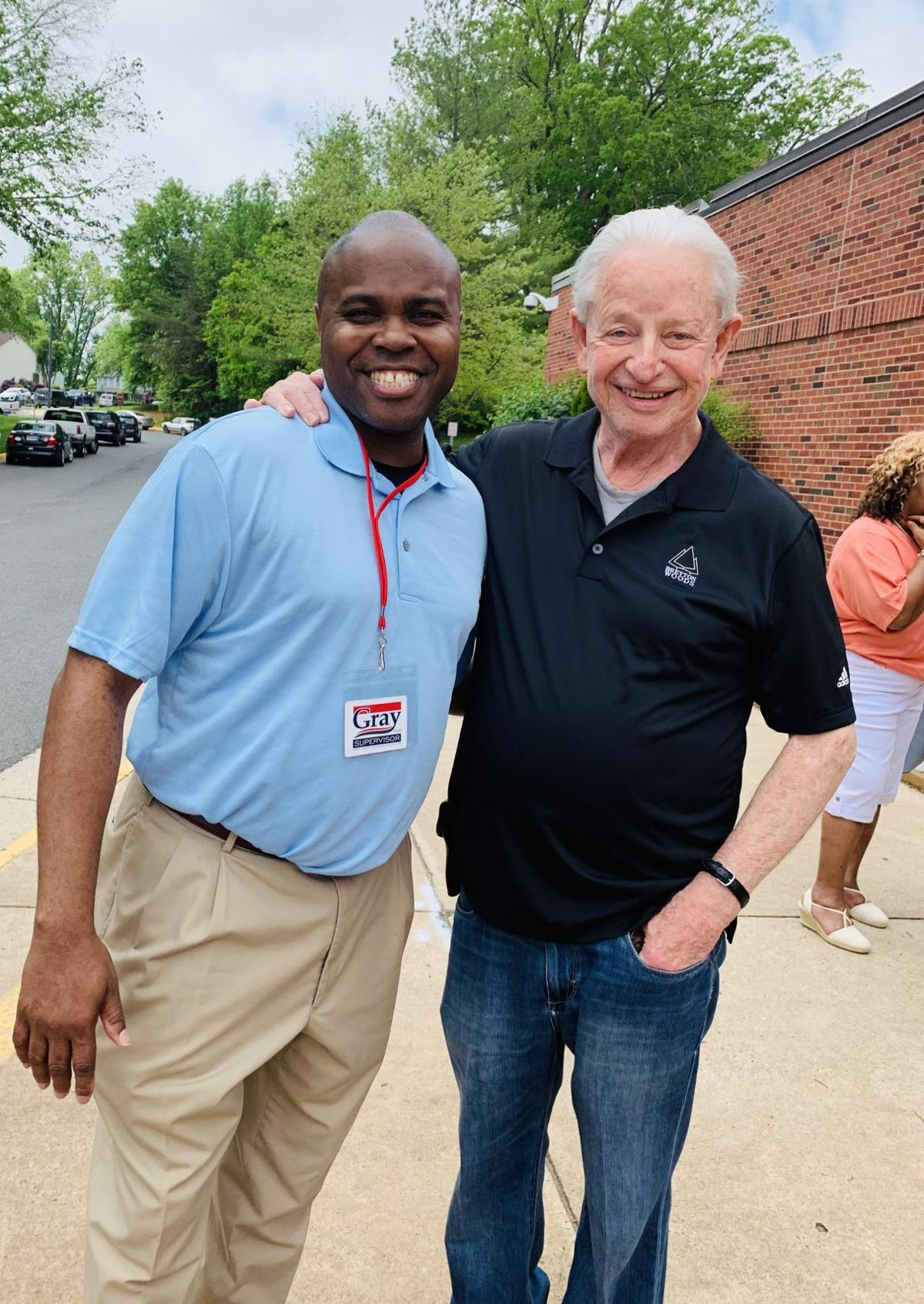 Davon Gray and supporter Peter Homan outside Montclair Elementary