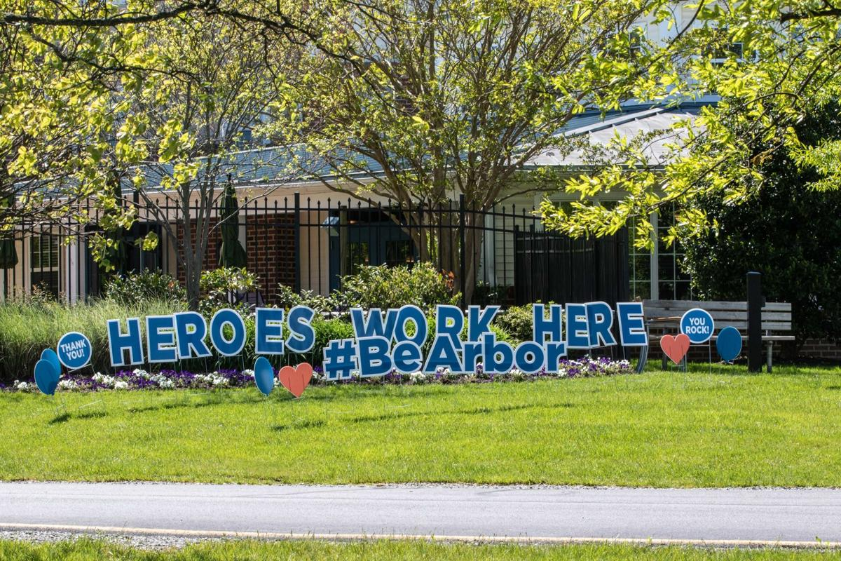 Arbor Terrace Sudley Manor workers sign 'heroes work here'