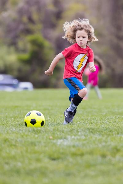 James S. Long park in Haymarket kid playing soccer