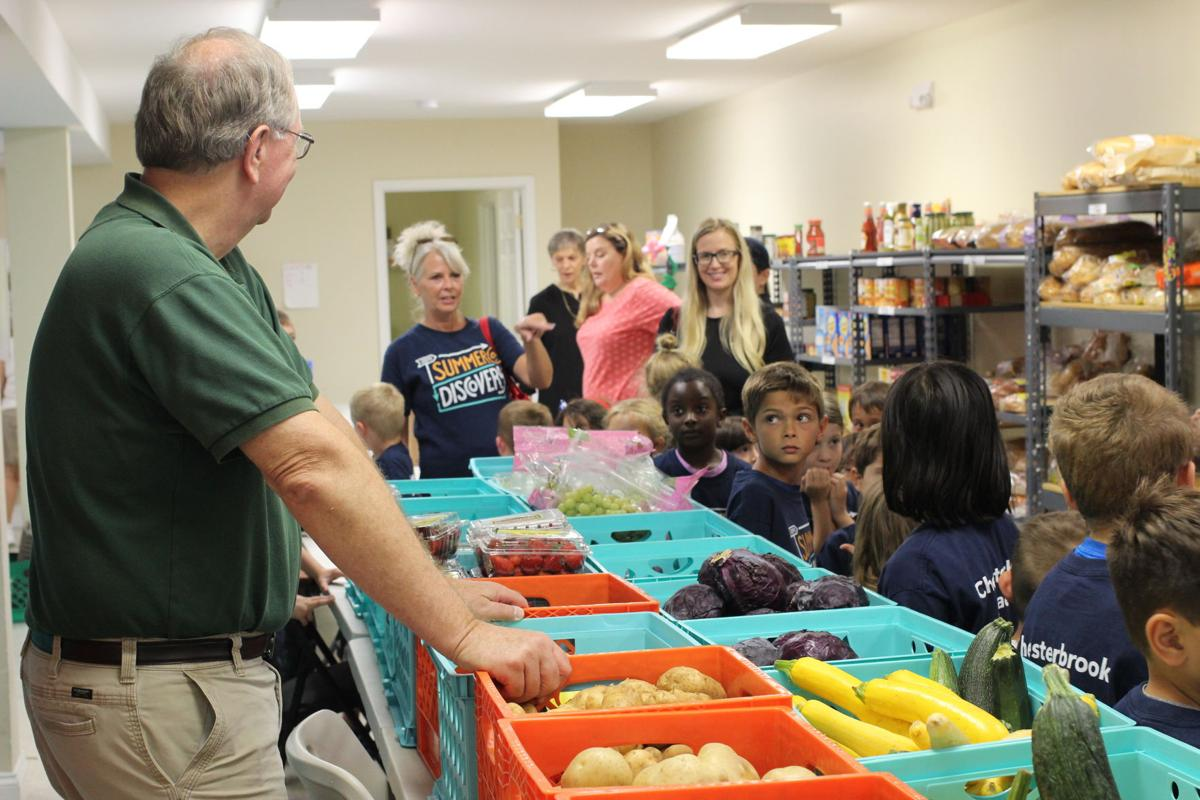 Chesterbrook Academy preschool students deliver food to the Haymarket food bank
