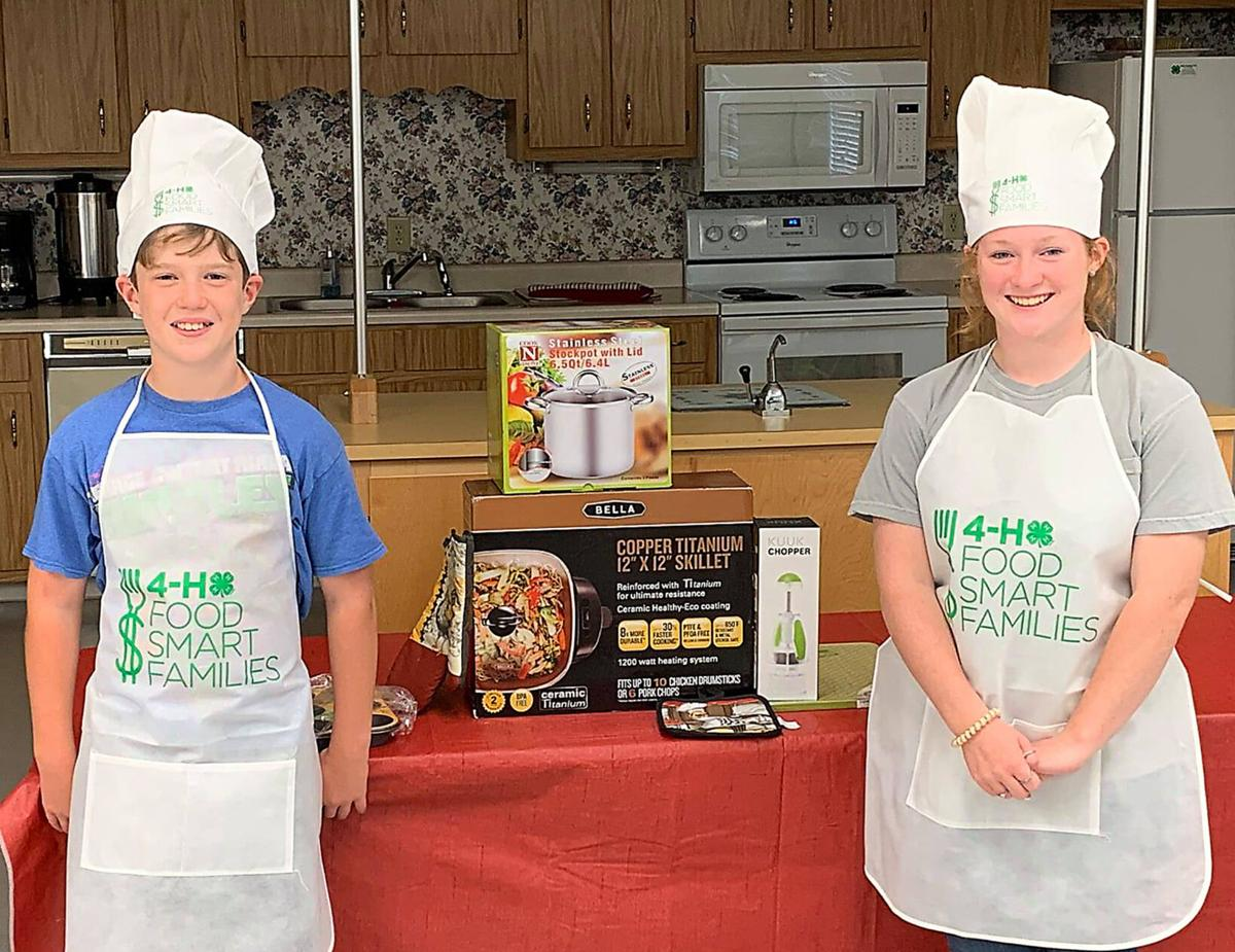 Avery and MaeLee Williamson receiving their prizes for the 4-H Chopped culinary contest web.jpg