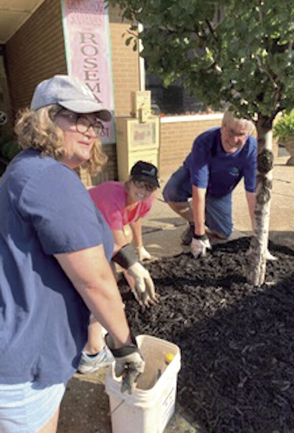 Volunteers turn out to clean up downtown