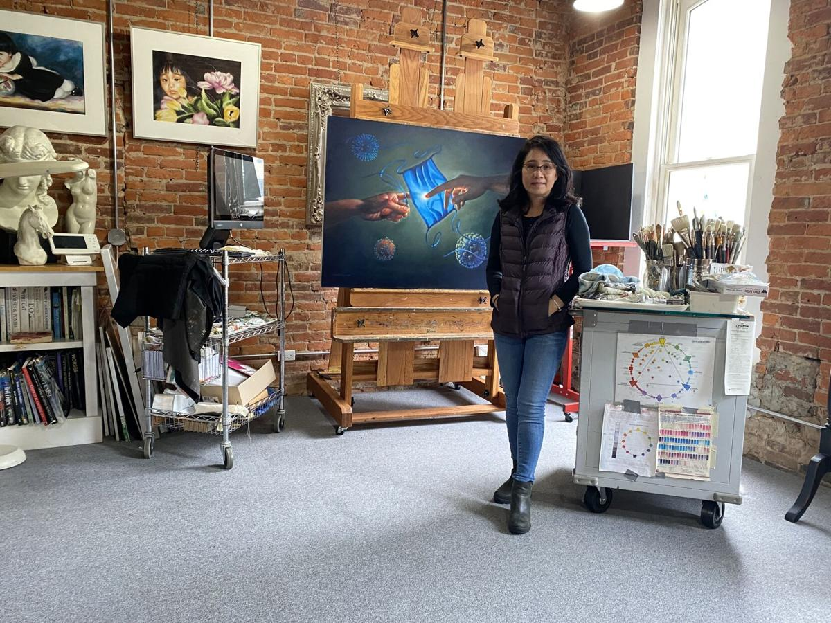 Kimlien Tran posing in front of painting
