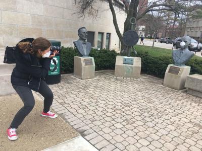 Masked statues: Graduate student raises awareness of coronavirus through photography