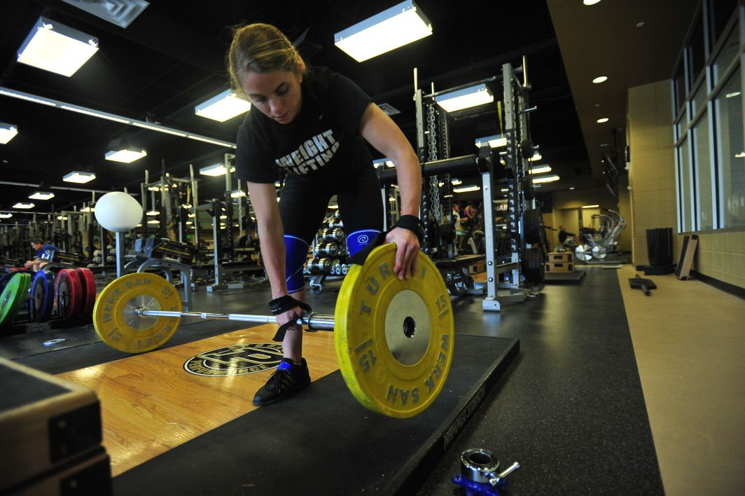 Former Purdue volleyball player shoulders weights of teaching, Olympic weightlifting | Campus ...