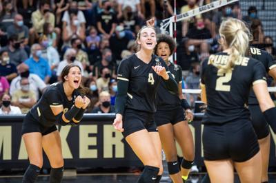 9/17/21 Volleyball, Caitlyn Newton celebrating