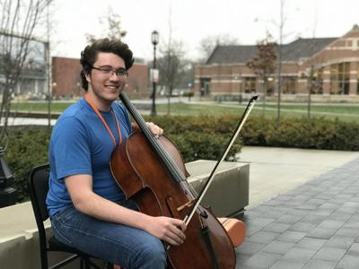 Fair weather brings out student cellist | Campus | purdueexponent org