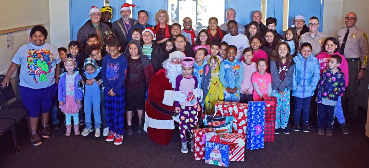 ISP staff gives presents to kids, seniors: Santa Claus joins local holiday visits