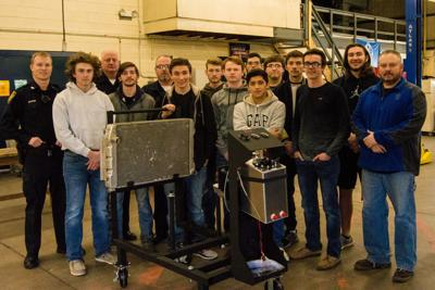 Mercer students, Aledo police group building 350 Chevy motor