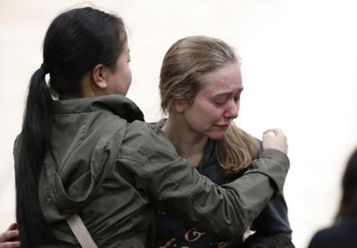 Young women console each other at vigil after Colorado school shooting