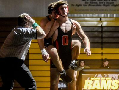 Lee's pin in prep wrestling debut sparks Orion early in opening-night victory