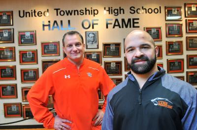 United Township's anthletic director Mark Pustelnik and wrestling coach Lambros Fotos