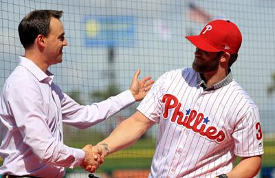 Bryce Harper is introduced to the Philadelphia Phillies by General Manager Matt Klentak during a news conference at Spectrum Stadium in Clearwater, Fla., on March 2, 2019. (Mike Ehrmann/Getty Images) **FOR USE WITH THIS STORY ONLY**