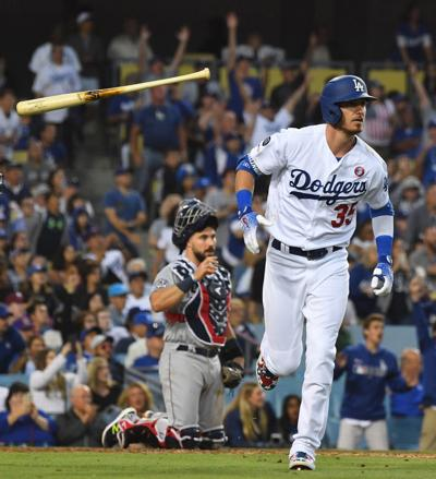 Cody Bellinger of the Los Angeles Dodgers throws his bat after hitting a solo home run in the sixth inning against the San Diego Padres at Dodger Stadium on Thursday, July 4, 2019, in Los Angeles.