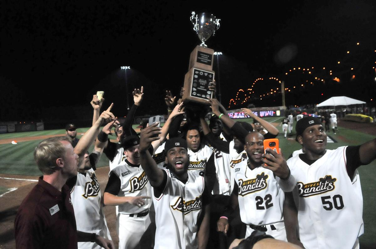Quad cities river bandits players hold up the midwest league championship trophy after winning game 3 of the best of five series against fort wayne on
