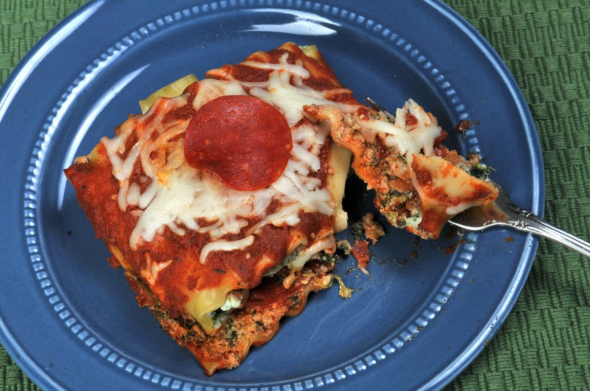 Roll it up: Lasagna dish sneaks in spinach, pleases pizza lovers