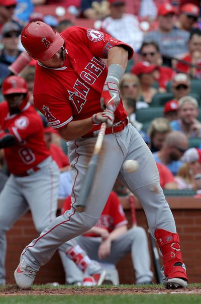 The Los Angeles Angels' Mike Trout singles in the third inning against the St. Louis Cardinals at Busch Stadium in St. Louis, Mo., on Saturday, June 22, 2019.