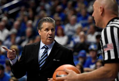 LEXINGTON, KY - NOVEMBER 26:  John Calipari, head coach of the Kentucky Wildcats, talks to a referee during the second half of the game between the Kentucky Wildcats and the Illinois-Chicago Flames at Rupp Arena on November 26, 2017 in Lexington, Kentucky.