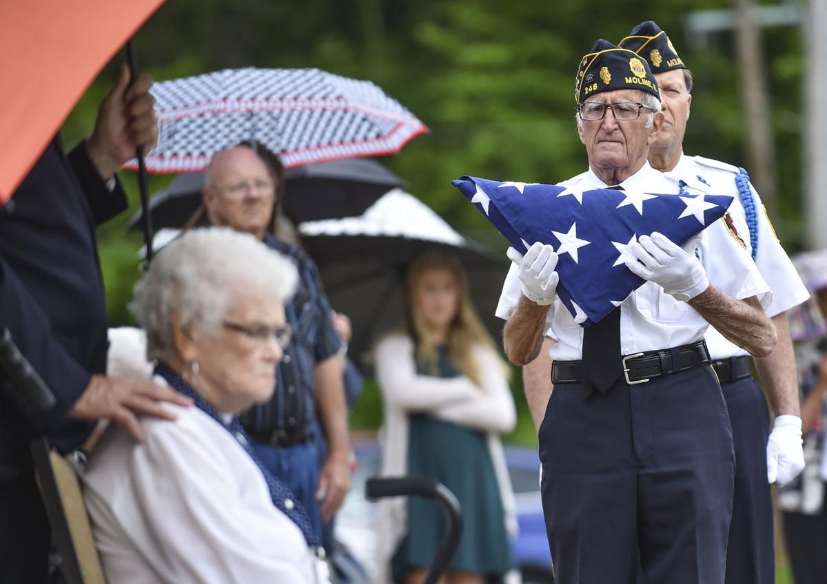 Jim Joseph delivers a flag