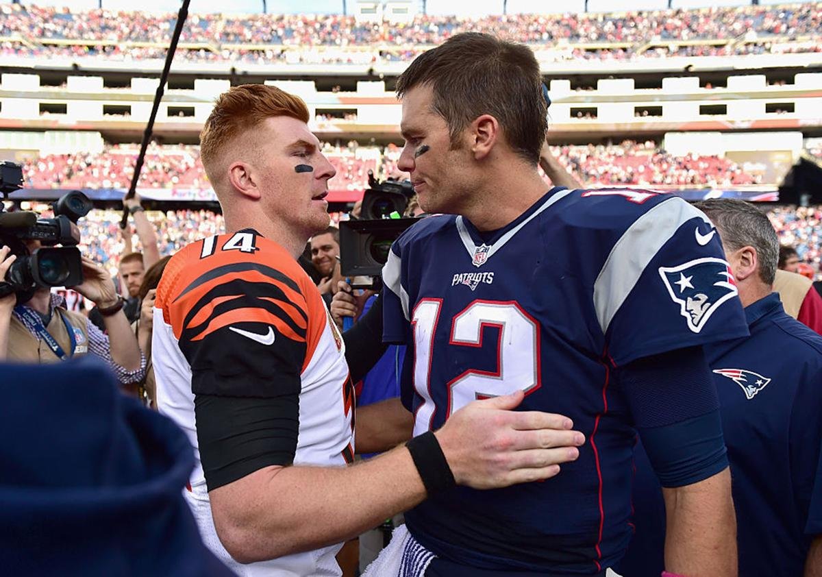 Tom Brady #12 of the New England Patriots reacts with Andy Dalton #14 of the Cincinnati Bengals following a game against the Cincinnati Bengals at Gillette Stadium on October 16, 2016 in Foxboro, Massachusetts.