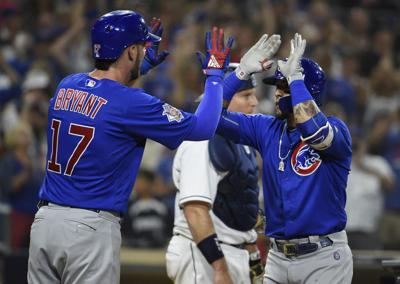 Javier Baez #9 of the Chicago Cubs is congratulated by Kris Bryant #17 after hitting a three-run home run during the ninth inning of a baseball game against the San Diego Padres at PETCO Park on July 14, 2018 in San Diego, Calif. (Denis Poroy/Getty Images/TNS