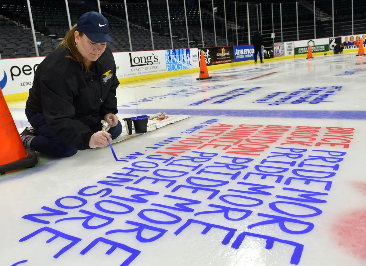 Salute To Military ice painting at the TaxSlayer Center
