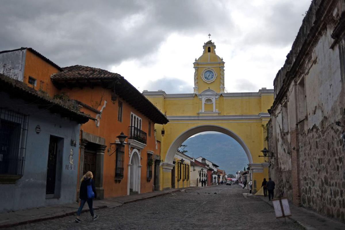 People walk in the streets of Antigua ahead of the XXVI Ibero-American Summit in Antigua on November 14, 2018. (JOHAN ORDONEZ/AFP/Getty Images/TNS) *FOR USE WITH THIS STORY ONLY*