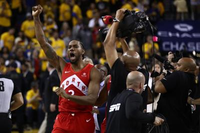 Kawhi Leonard of the Toronto Raptors celebrates his team's win against the Golden State Warriors to capture the NBA championsip at ORACLE Arena in Oakland, Calif., on June 13, 2019. (Ezra Shaw/Getty Images/TNS) **FOR USE WITH THIS STORY ONLY**