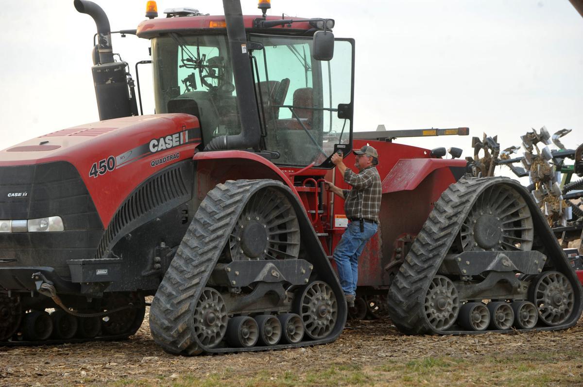 Michael Zecher, president of Mercer County Farm Bureau works his farm during harvest.