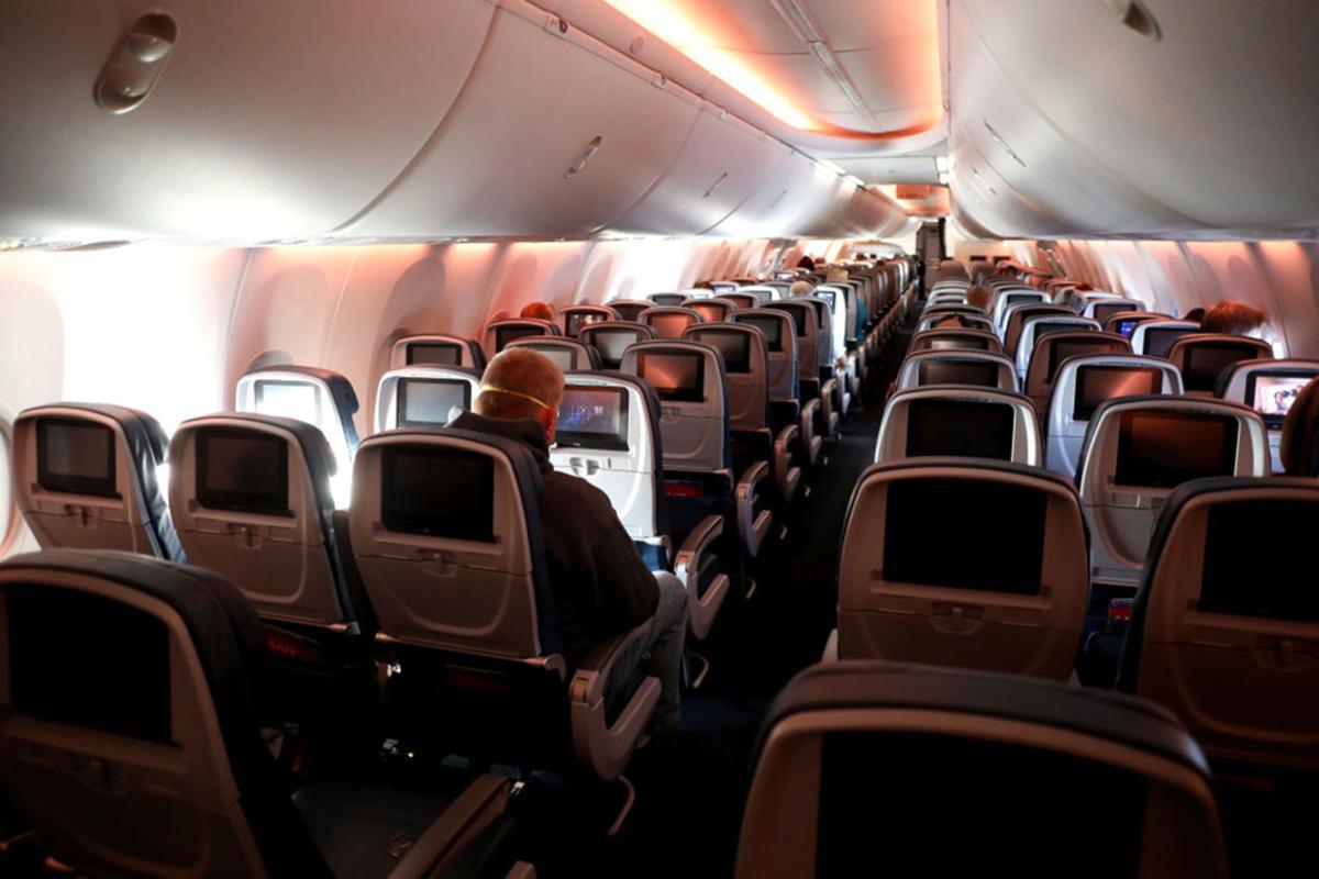 Passengers are seen in a cabin mid-flight on a Baltimore, Maryland bound Delta flight from Hartsfield-Jackson Atlanta International Airport on April 20, 2020 in Atlanta, Georgia.