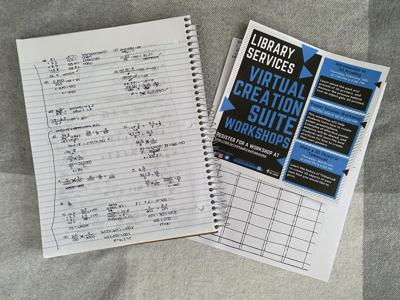 The Library Creations Suite flyer and an open notebook