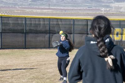Lady Jacks players throw to warm up at the start of practice on March 11. About 40 girls turned out for the team this season