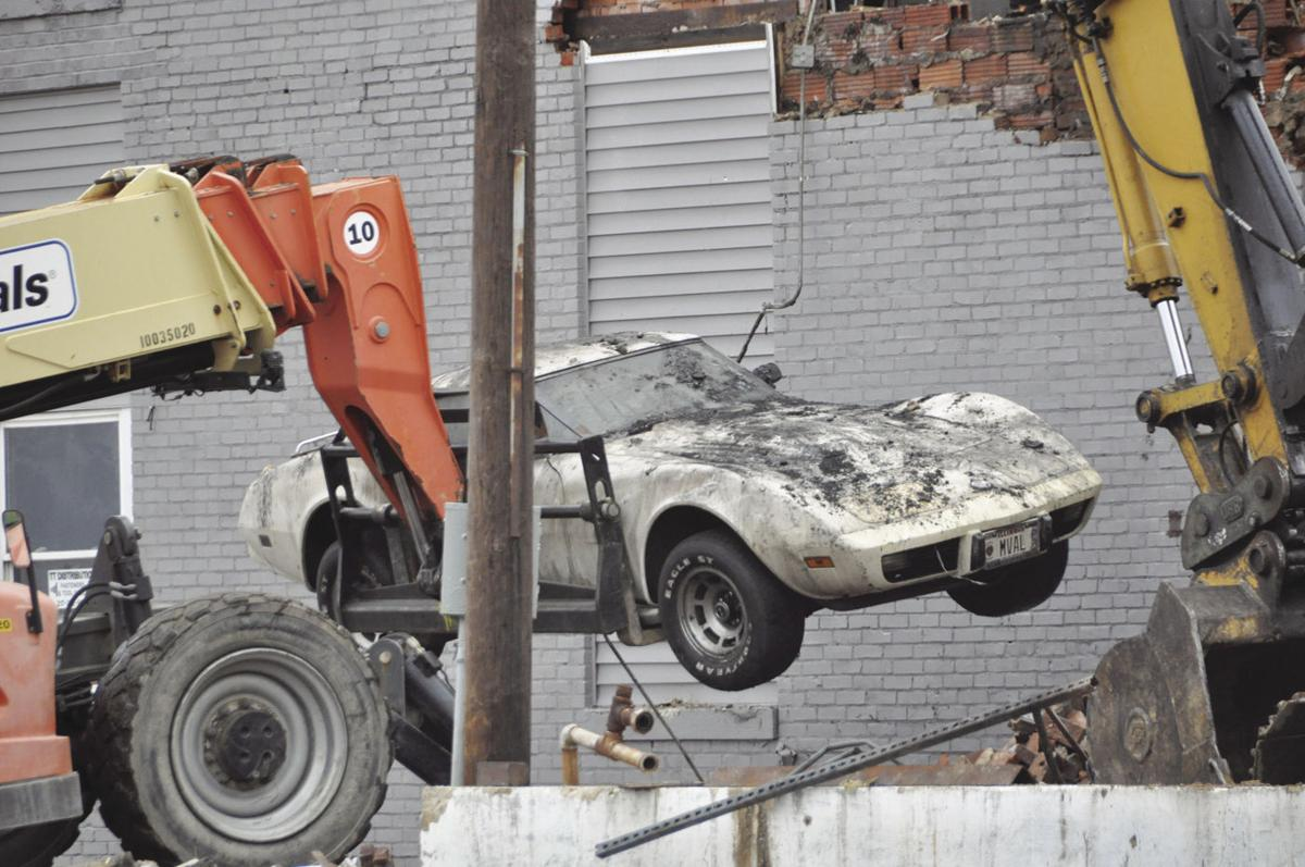 It took a licking and keeps on ticking: Corvette removed from burned-out building