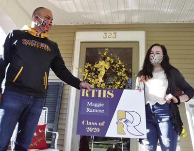 RTHS seniors receive yard signs, caps and gowns for graduation