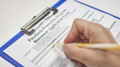 A Person Filling Application Form. Apply For The Paycheck Protection Program With An Eligible Lender