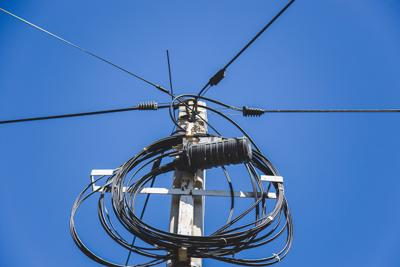 Transformer And Power Lines On Electric Pole. Fiber Optic Tv And Internet Cable.
