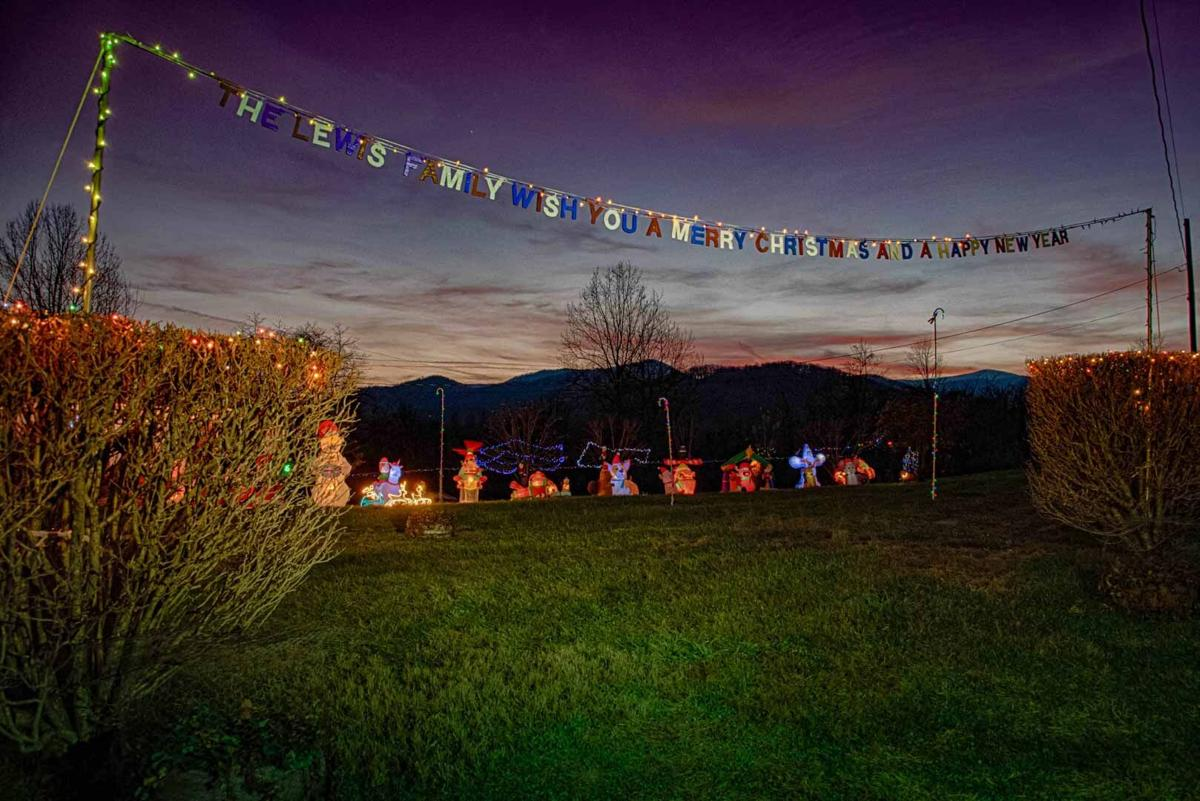 Tom Lewis welcomes visitors to enjoy his incredible display of holiday lights