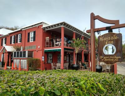 Grab food and drink at one of Bermuda's most famous pubs, the Swizzle Inn.