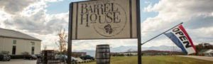 Blue Mountain Barrel House Sign with Open flag.jpg