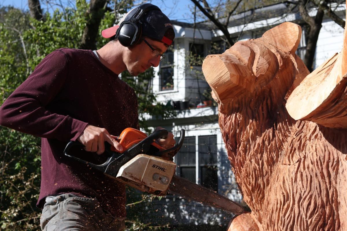 A chainsaw artist transformed an Athens pecan tree into a