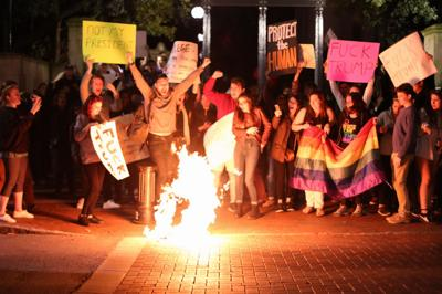 Anti-Trump protesters gather at the UGA Arch Wednesday night