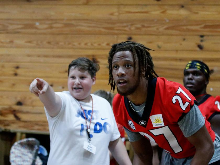PHOTOS: UGA football team's annual trip to Camp Sunshine