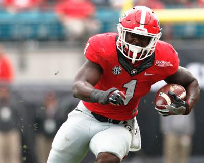 Georgia tailback Sony Michel (1) runs the ball during an NCAA college  football game between The University of Georgia and Pennsylvania State  University 68377bd43