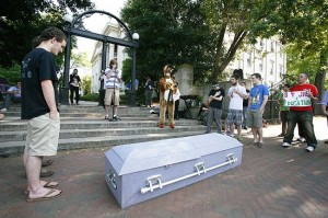 CHOP FROM THE TOP': Students protest by holding funeral for