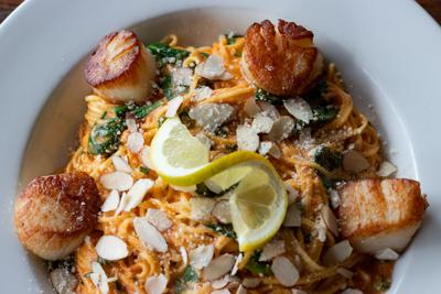 """Sea scallops with tomato saffron sauce from DePalma's, one of the first restaurants to commit to """"Ready, Set, Go Safely."""""""