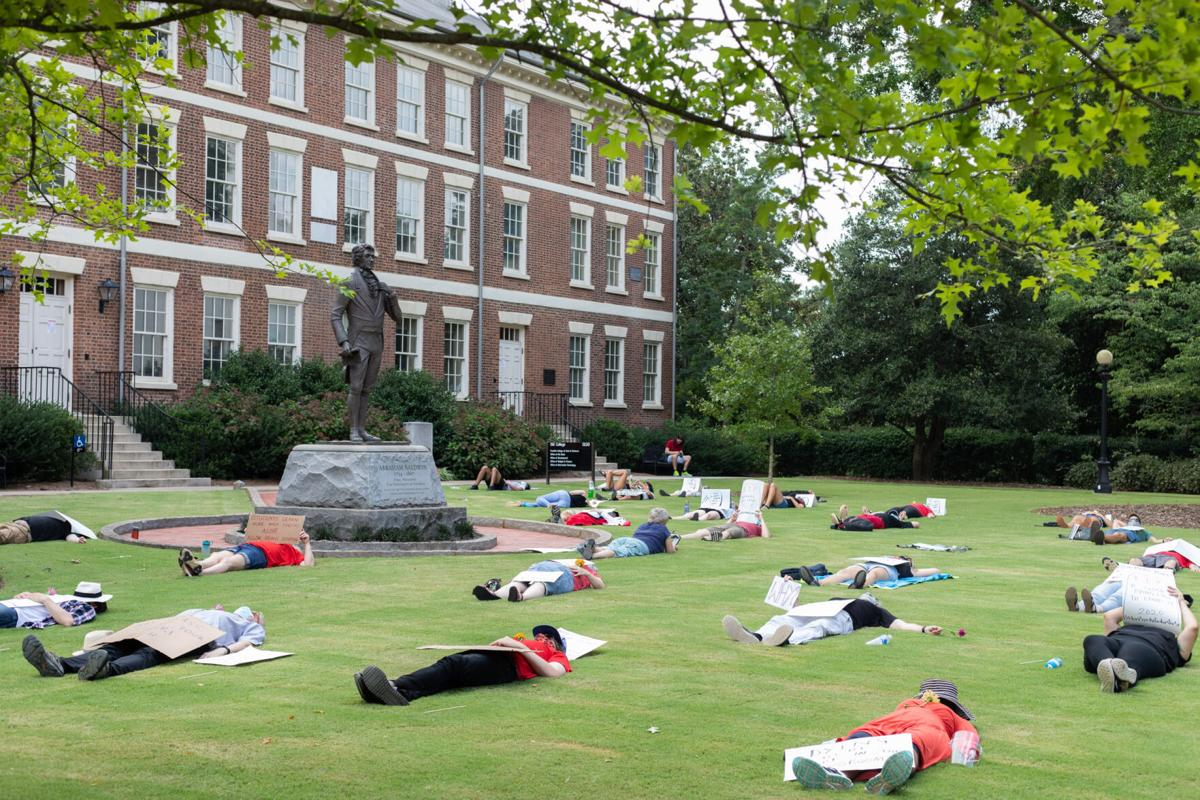 PHOTOS: UGA community members participate in die-in protest