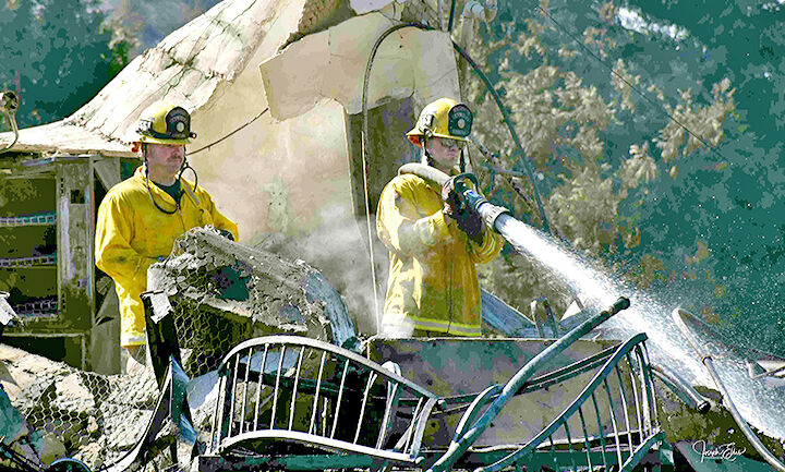 Firefighters douse hot spots at Los Rios Rancho fire