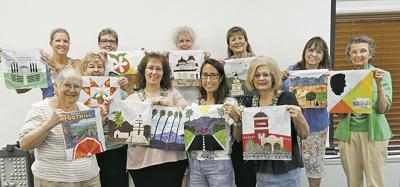 Redlands quilters with their blocks